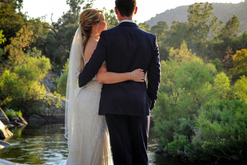 wedding couple together by the river